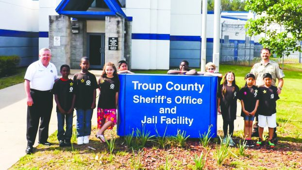 Troup County Schools' third graders Sheriff for a day - pictured outside TCSO office